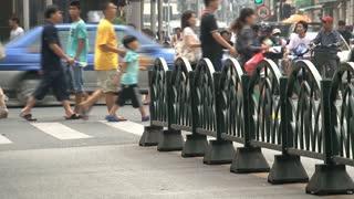 People walking at an pedestrain in Shanghai