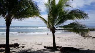 People walking at Playa Santa Teresa in Costa Rica