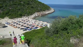 People walking down the stairs to skala marion beach in Thassos Greece