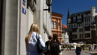 People walking in the Old Town of Riga Latvia