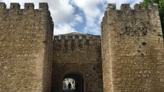 People walking through the gate at the Castelo dos Governadores in Lagos Algarve, Portugal