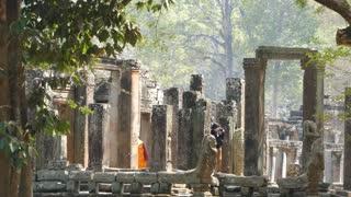 Photographing Monks at the Bayon Khmer temple at Angkor Wat Cambodia