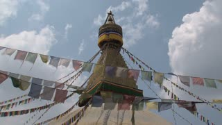 Prayer flags in the wind in front of the Boudha stupa in Kathmandu