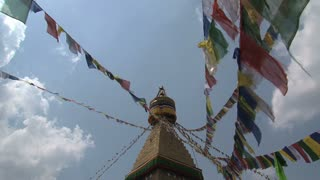 Prayer flags in the wind reaching the top of the Boudha stupa
