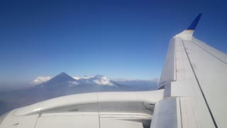 Prepare for landing in to La Aurora International Airport Guatemala City with the Pacaya Vulcano at the background