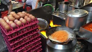 Preparing Pad Thai at Thip Samai one of the most famous Pad Thai restaurants in Bangkok Thailand