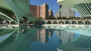 Reflection in the water of the Berklee College of Music at the City of Arts and Sciences in Valencia Spain