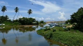 River with fishing boats in Dodanduwa in Sri Lanka