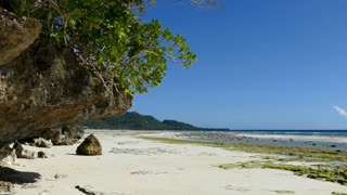 Rocky coastline at Anda beach in the morning during low tide in Bohol Island the Philippines