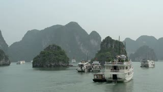 Sailing through Ha Long Bay with all the cruise ships