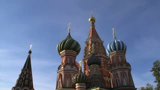 Saint Basil's Cathedral tilt down with a man passing by