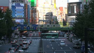 Shinjuku crossing with trains at the background end of day in Tokyo, Japan