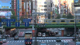 Shinjuku, Tokyo, Japan crossing with a train at the background