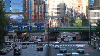 Shinjuku, Tokyo, Japan crossroad and train at daytime