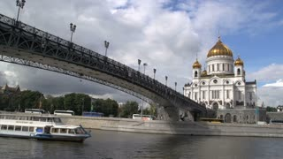 ship passing by a bridge and the Cathedral of christ the saviourship