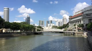 Singapore river with the Cavenagh Bridge and Mansion Bay at the background