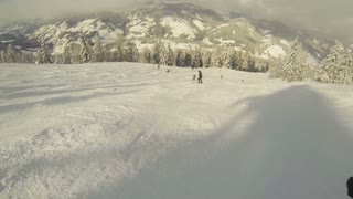 Skiing at the piste in Flachau, Austria on a sunny day