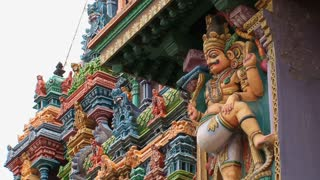 Slow Zoom out from a statue of the The Meenakshi Temple, Madurai, India