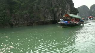 Small boat with goods from local people in Ha Long Bay