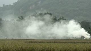 Smoke above farm land in Mai Châu