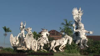 Statue and traffic in Bali