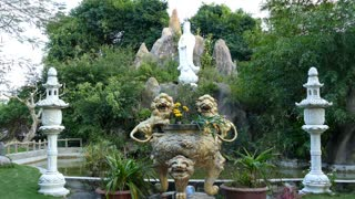 Statues and garden at the Chuc Thanh Pagoda in Hoi An Vietnam
