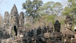 Statues and gate in Angkor Wat Cambodia