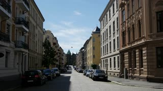 Street in Oslo with the Frogner Church in the background
