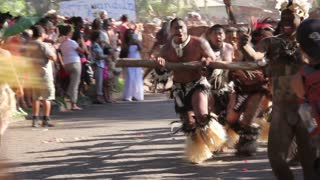 Strong men from the marquesas islands at the Tapati parade pulling wood at the Easter Island, Rapa Nui