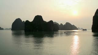 Sunrise at Ha Long Bay with a boat in the background
