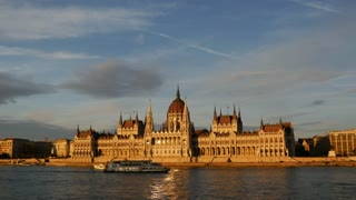 Sunset with cruise ships and the Hungarian Parliament Building at the Danube river in Budapest, Hungary