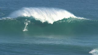 Surfer at the big wave surfing break Jaws in Peʻahi at the north shore of the island of Maui, Hawaii