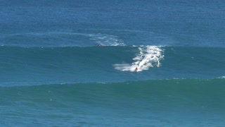 Surfers and jetski at the big wave surfing break Jaws in Peʻahi at the north shore of the island of Maui, Hawaii