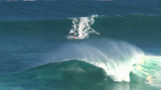 Surfers at the big wave surfing break Jaws in Peʻahi at the north shore of the island of Maui, Hawaii