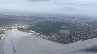 Takeoff from Schiphol Airport flying above Amsterdam in The Netherlands