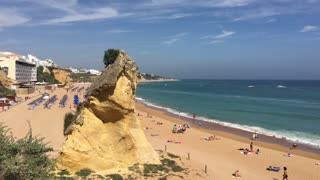 The beach in Albufeira with a big rock