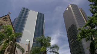 The Cathedral of St Stephen and modern skyscrapers in Brisbane