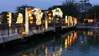 The Cau An Hoi bridge in the evening with Floating lanterns in the water in Hoi An Vietnam