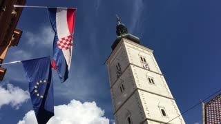 The European and Croatian flag next to the St. Mark's Church in the old town of Zagreb Croatia