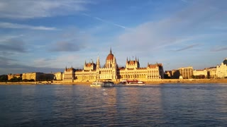 The Hungarian Parliament Building (Parliament of Budapest) with cruise ships passing by