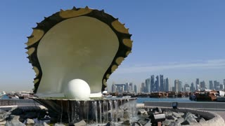 The Pearl Monument and fountain located along the Dhow Harbour with the Doha skyline in the background