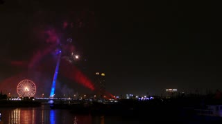 The Trần Thị Lý Bridge and Sun Wheel with fireworks celebrating Chinese New Year in Da Nang, Vietnam