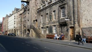 Tilt after a london taxi passing by in the old town of Edinburgh Scotland