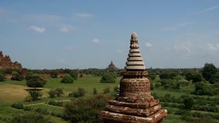 Tilt from a pagoda to the Dhammayan Gyi Temple in Bagan, Myanmar, Burma