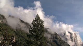 Tilt from clouds to landscape
