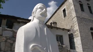 Tilt from statue to building in Theologos in Thassos Greece