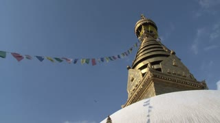 Tilt from Swayambhunath stupa, monkey temple with prayer flags to the prayer wheels with people passing by