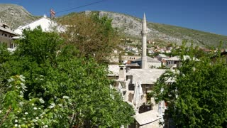 Tilt from the city Mostar to a river in Bosnia and Herzegovina