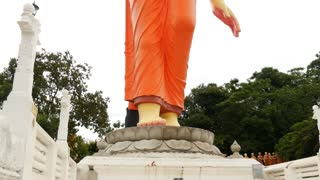 Tilt from the world�s tallest walking statue of the Buddha at Ranawana Temple in Kandy district, Sri Lanka