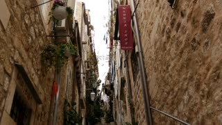 Tilt to a narrow street with stairs in Dubrovnik Croatia